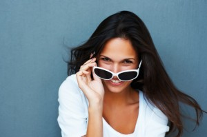 photodune-217105-playful-woman-wearing-sunglasses-and-smiling-xs