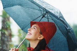photodune-220307-woman-smiling-under-umbrella-xs